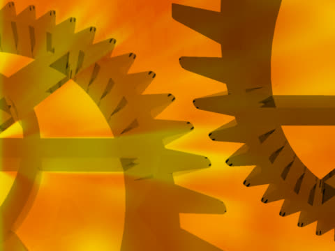 close-up of two gears spinning - manipolazione di colore video stock e b–roll