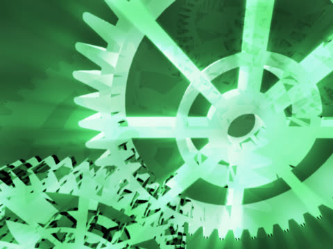close-up of two interlocked gears spinning - manipolazione di colore video stock e b–roll