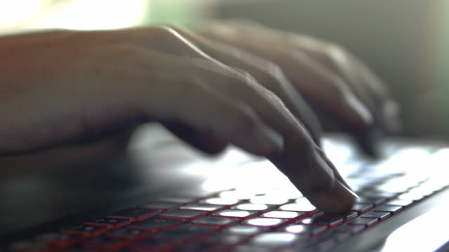 close-up of typing on laptop keyboard - computer keyboard stock videos & royalty-free footage