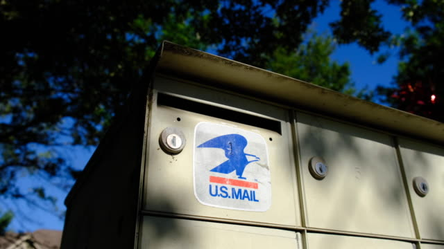 closeup of us mail logo. bloomington, indiana, united states - : a united states post office letterbox in the hyde park neighborhood of bloomington,... - time of day stock videos & royalty-free footage