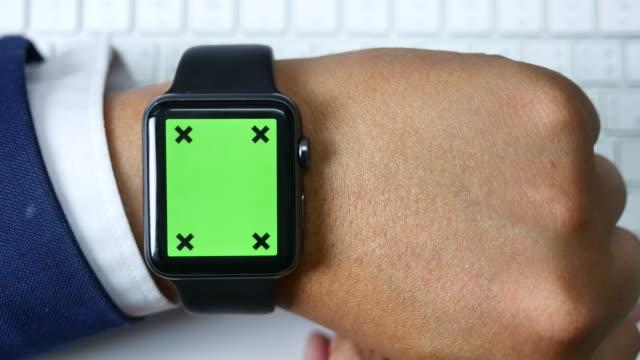 Close-up of using smart watch, Green screen