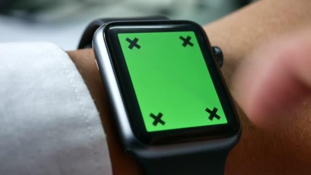 Close-up of using smart watch,Green screen