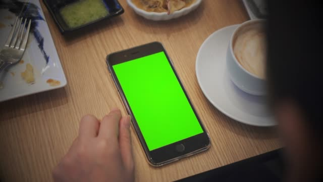 close-up of using smartphone in restaurant,green screen - over the shoulder view stock videos & royalty-free footage