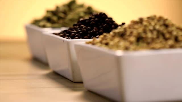 close-up of variety of indian spices - spice stock videos and b-roll footage