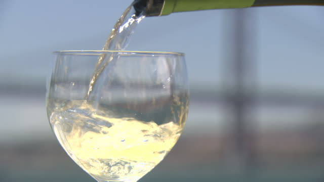 Close-up of view of Vinho Verde being poured into a wine glass, Lisbon, Portugal.