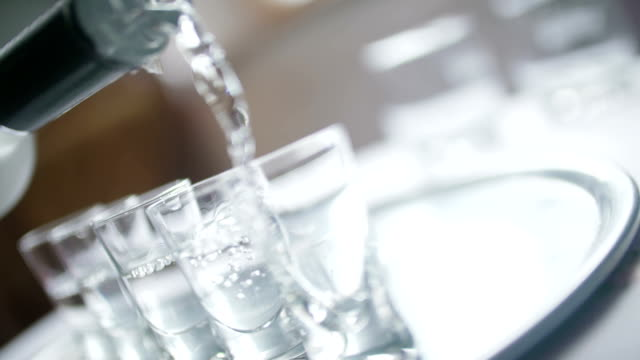 Close-up of Vodka Poured into a Shot Glass.