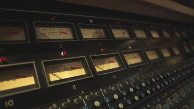stockvideo's en b-roll-footage met close-up of vu meters on a sound mixer - analog