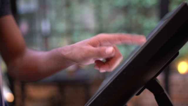 close-up of waiter using a computer monitor to take the order - touch screen stock videos & royalty-free footage