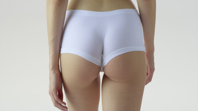 close-up of walking woman'‎s butt in white underwear. - thigh stock videos & royalty-free footage