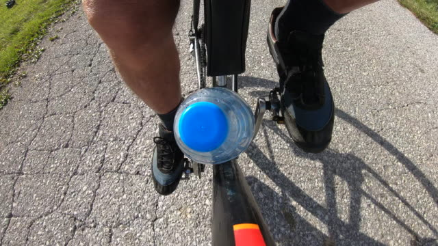 close-up of water bottle and senior man cycling - low section stock videos & royalty-free footage