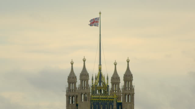 close-up of waving flag on top of Westminster Abbey in London