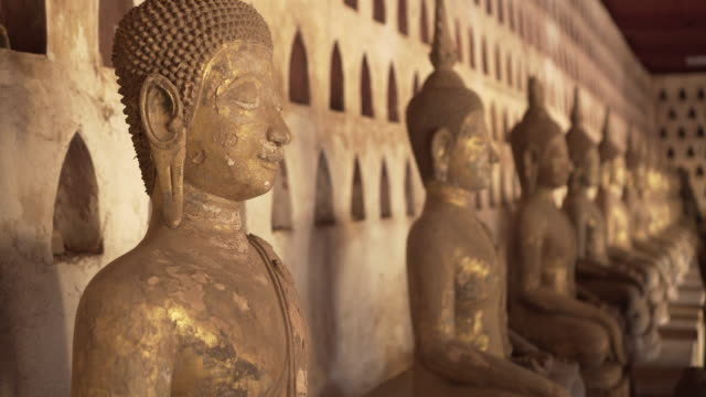 close-up of weathered buddha statues against wall at famous buddhist temple museum - vientiane, laos - weathered stock videos & royalty-free footage
