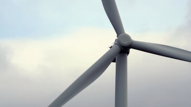close-up of wind turbine rotor blades spinning - tall high stock videos & royalty-free footage