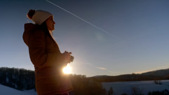 close-up of winter traveler at sunset using camera, close up of one young woman tourist taking photos, photographing, enjoying the winter mountain, portrait, winter sport, travel, exploration, adventure, tourism, outdoors, mountain hiking, - side lit stock videos & royalty-free footage