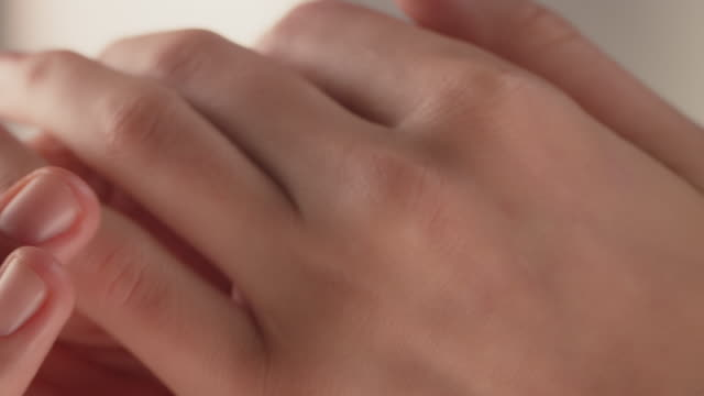 close-up of woman caressing her smooth hands - rubbing stock videos & royalty-free footage