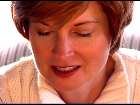 close-up of woman concentrating - only mature women stock videos & royalty-free footage
