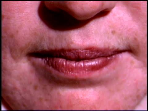 close-up of woman grimacing - nur frauen über 40 stock-videos und b-roll-filmmaterial