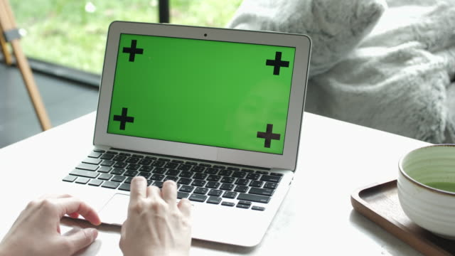 close-up of woman hands using laptop with green screen at cafe - green background stock videos & royalty-free footage