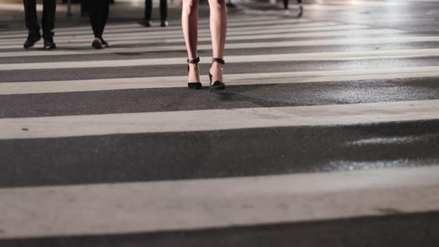 closeup of woman in high heels walking across a crosswalk - high heels stock videos & royalty-free footage