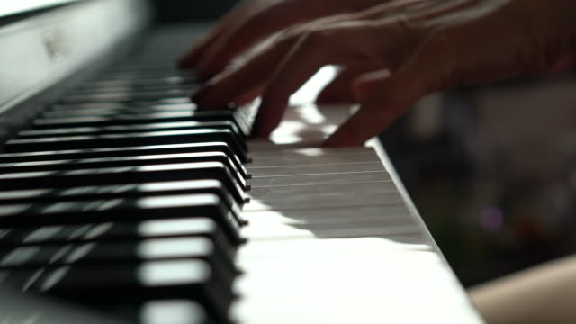 close-up of woman playing a piano - piano stock videos and b-roll footage