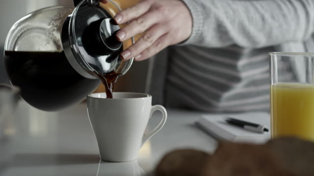 close-up of woman pouring coffee - morning stock videos & royalty-free footage