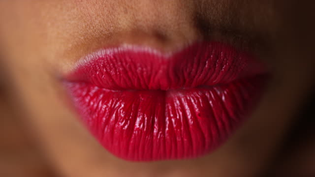 closeup of woman pressing lips together - lippen stock-videos und b-roll-filmmaterial