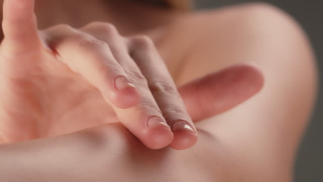 close-up of woman touching her flawless arm skin - smooth stock videos & royalty-free footage