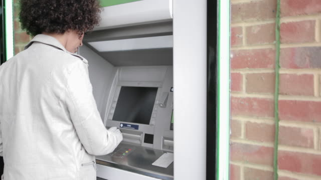 closeup of woman using an atm - paper currency stock videos & royalty-free footage