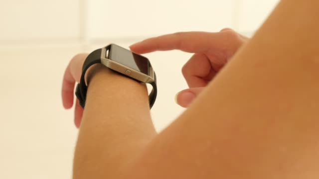 close-up of woman using smart watch in dance class - exercise class stock videos & royalty-free footage