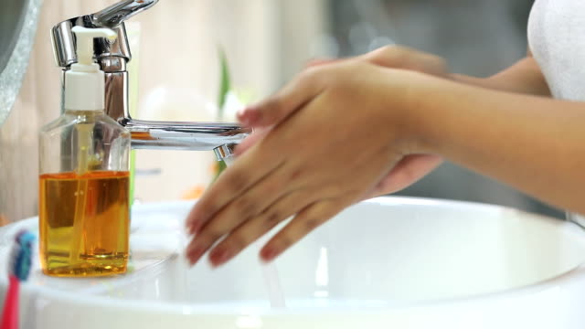 close-up of woman washing her hands in bathroom, delhi, india - 部分 個影片檔及 b 捲影像