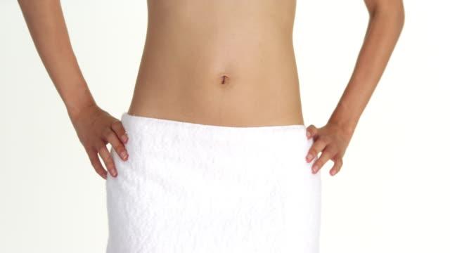 Closeup of woman wearing towel around waist