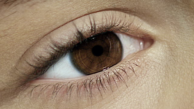 close-up of woman's eye. - zoom in stock videos & royalty-free footage