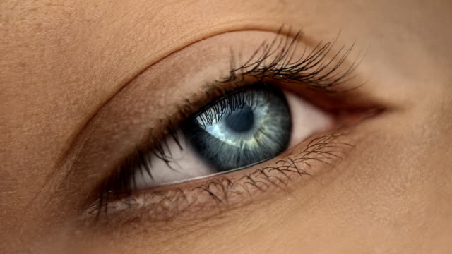 close-up of woman's eye - green eyes stock videos and b-roll footage