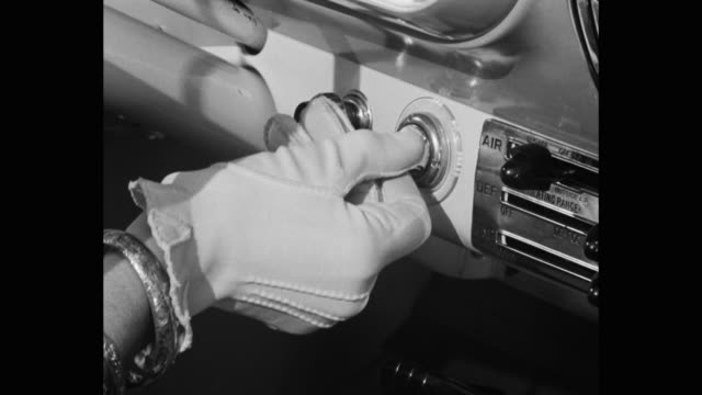 close-up of woman's hand turning key in ignition on car dashboard - glove stock videos & royalty-free footage