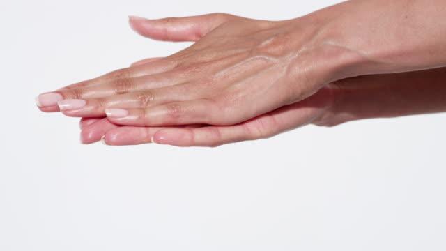 close-up of woman's hands massaging moisturiser - human finger stock videos & royalty-free footage