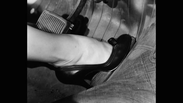 close-up of woman's leg pressing brake pedal of car - leather stock videos & royalty-free footage