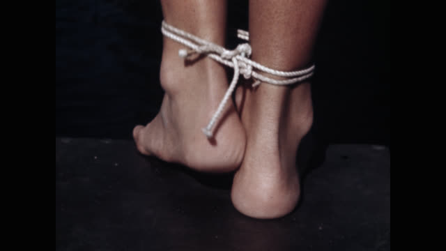 close-up of woman's legs tied up with rope - 縛られる点の映像素材/bロール