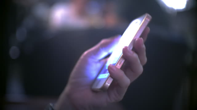 close-up of women using smart phone at night - scrolling stock videos & royalty-free footage