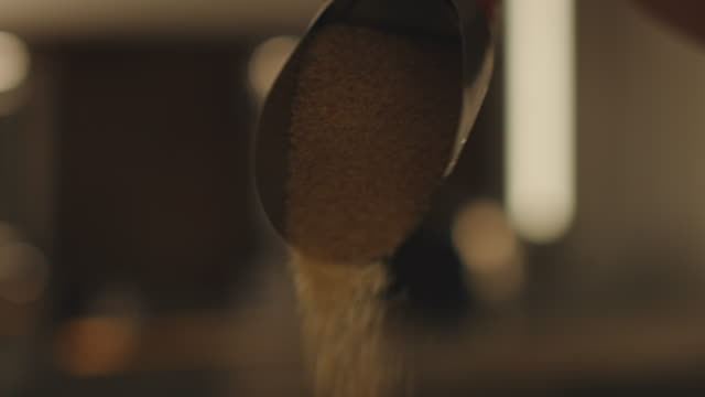 close-up of worker pouring brown sugar at factory - serving scoop stock videos & royalty-free footage