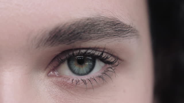 close-up of young adult woman eye opening - beauty in nature stock videos & royalty-free footage