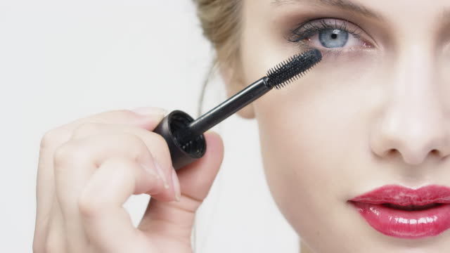 close-up of young woman applying mascara - skin care stock videos & royalty-free footage