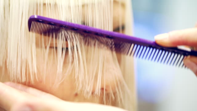 close-up of young woman at hairdresser - bangs stock videos & royalty-free footage