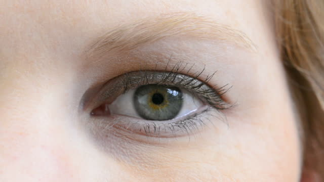 close-up of young womans eye and face blinking abstract mr model released - blinking stock videos & royalty-free footage
