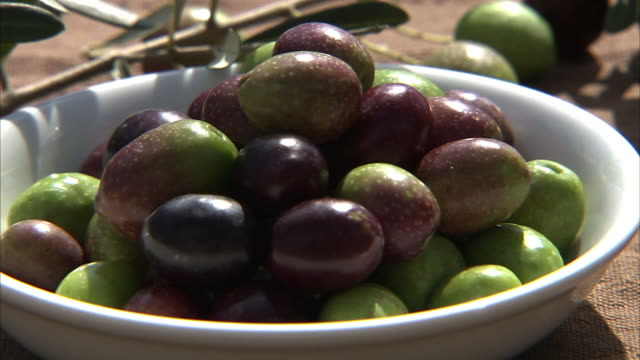 closeup; olive fruits and oil outside - olive fruit stock videos and b-roll footage