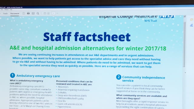 close-up on a computer monitor as a doctor scrolls through a&e and hospital admissions advice for winter for the imperial college nhs trust, london,... - trust stock videos & royalty-free footage