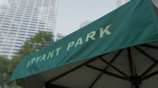 close-up on an umbrella at bryant park, new york city - bryant park stock videos and b-roll footage