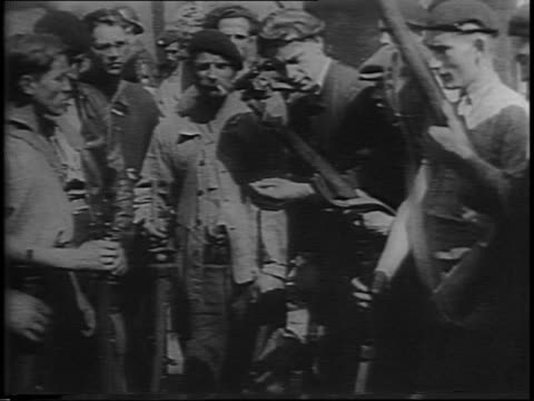 close-up on belgian soldier / belgian soldiers firing field gun / close-up of artillery gun firing / group of french maquis troops walking down road... - man and machine stock videos & royalty-free footage