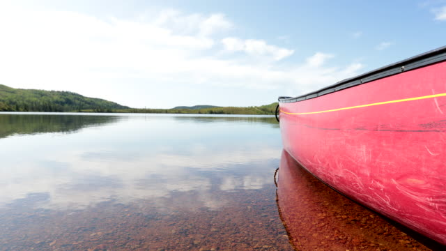 close-up on canoe on the lake in the summer at parc national des grands-jardins, quebec, canada - parc national stock videos & royalty-free footage