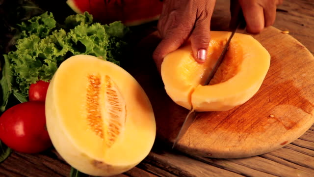 closeup on slices of melon in hand of woman - slice stock videos & royalty-free footage