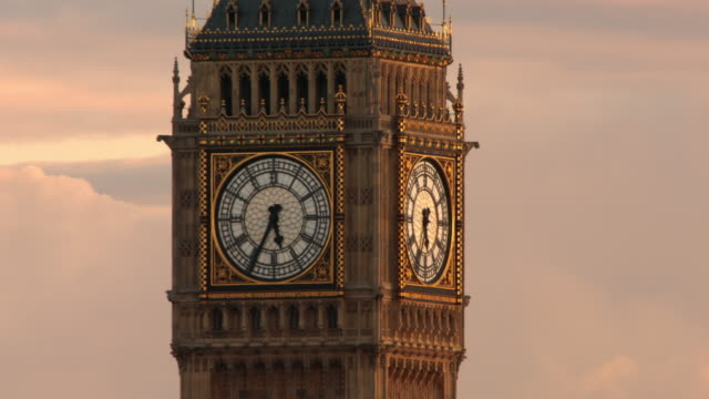 close-up on the clock of the big ben tower in london. - römische zahl stock-videos und b-roll-filmmaterial